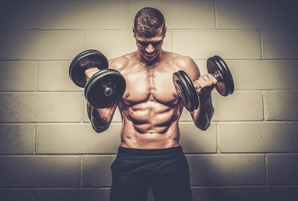 Fit Young Man Lifting Weights